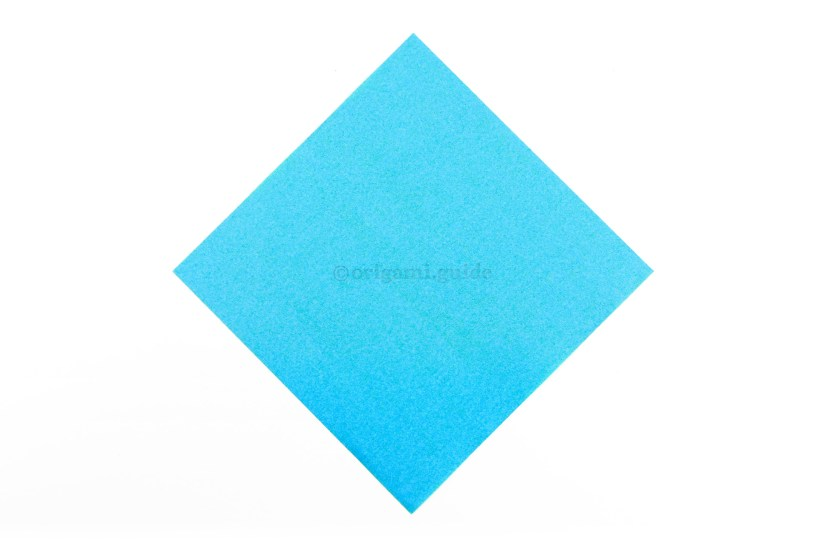 1. This is the front of our origami paper, the dove will end up being this colour.