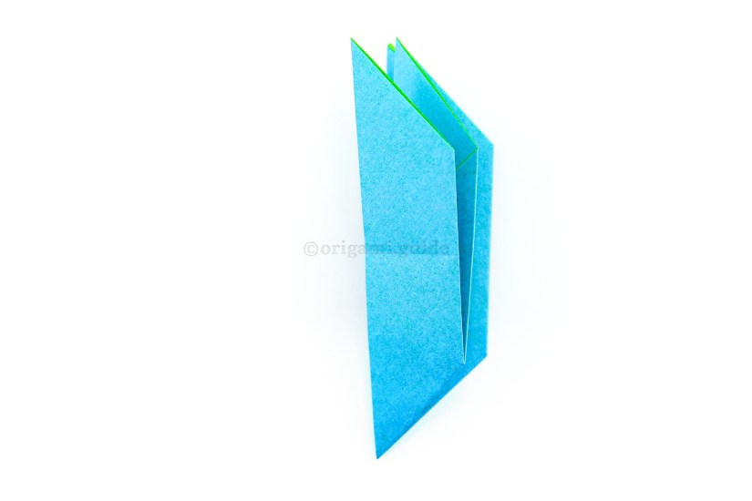 16. Fold the left edge over to the right edge. Make sure the open ends are at the top.