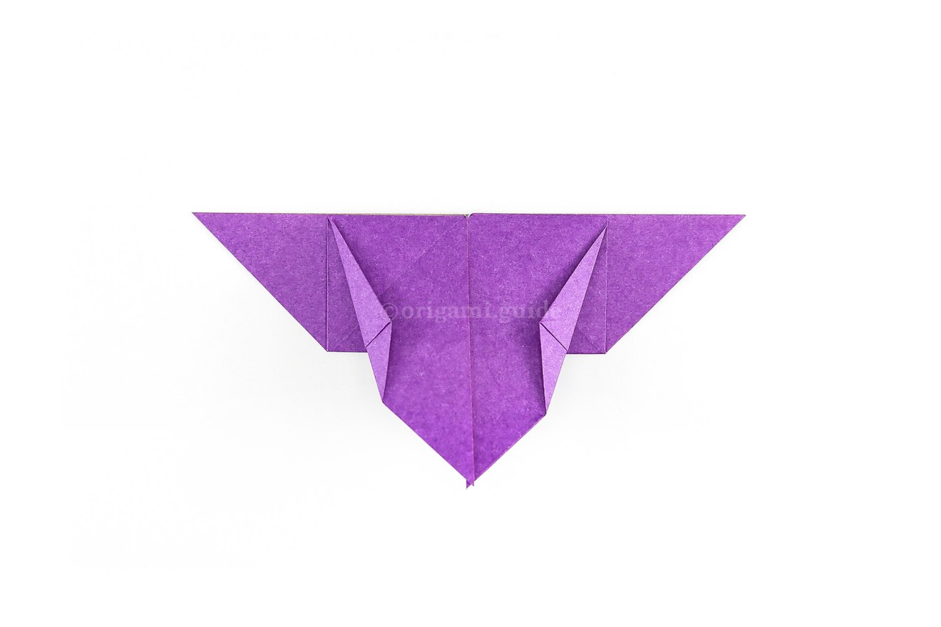 Next fold the outer diagonal edges of the lower flaps in a little bit as shown.