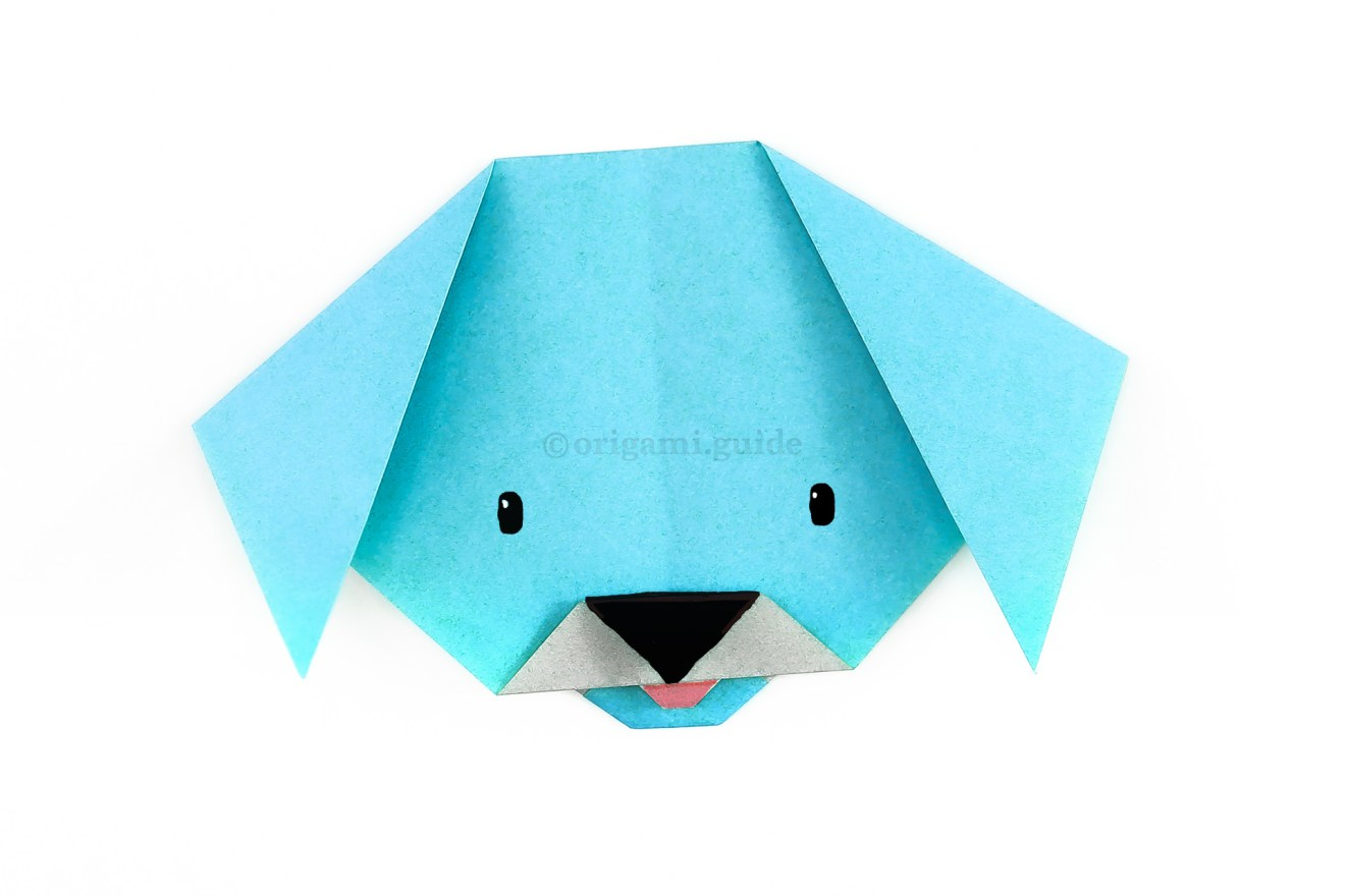 Finally, you can draw a face on your origami dog, even use some pens to colour the nose and tongue.