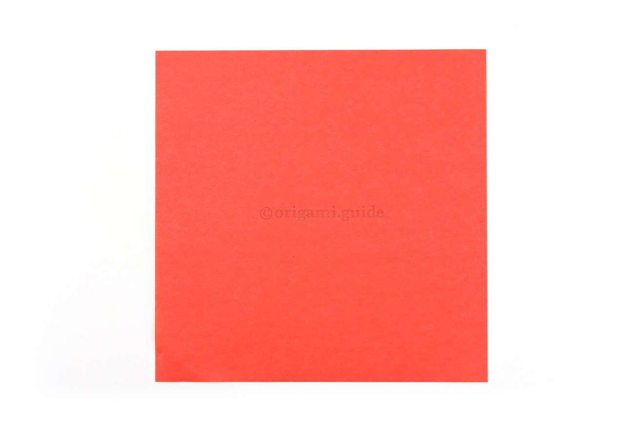 This is the front of our origami paper, which is red. Our flower will have red petals.