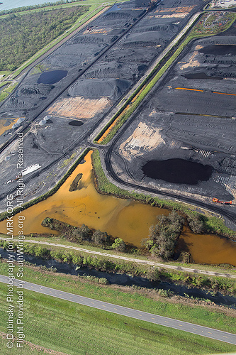Contaminated water flows off the coal piles