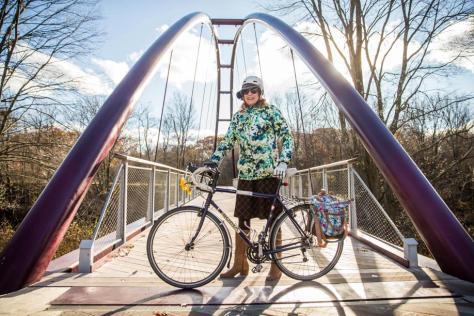 Jessica and her bike on the Harvest River Bridge.