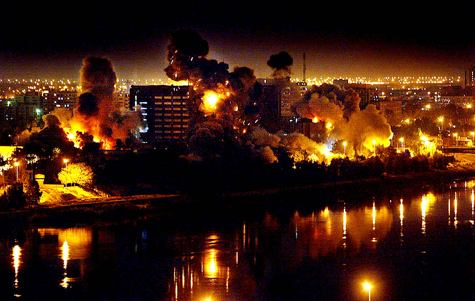 On the second night of war against Iraq, bombs fall on government buildings located in the heart of Baghdad along the Tigris River.  Multiple bombs left several buildings in flames and others completely destroyed.