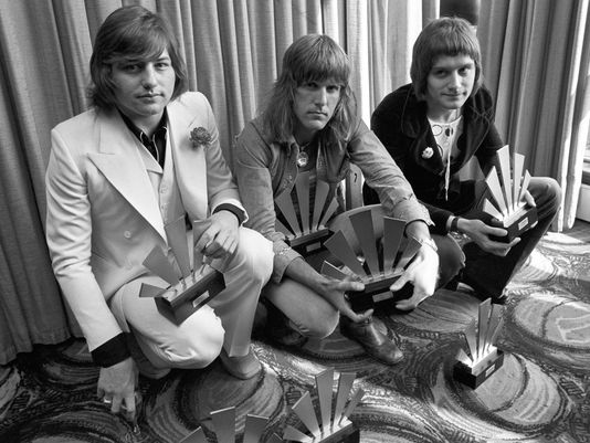 Greg Lake (left) in a 1972 ELP photo with Keith Emerson and Carl Palmer. (Source: AP)
