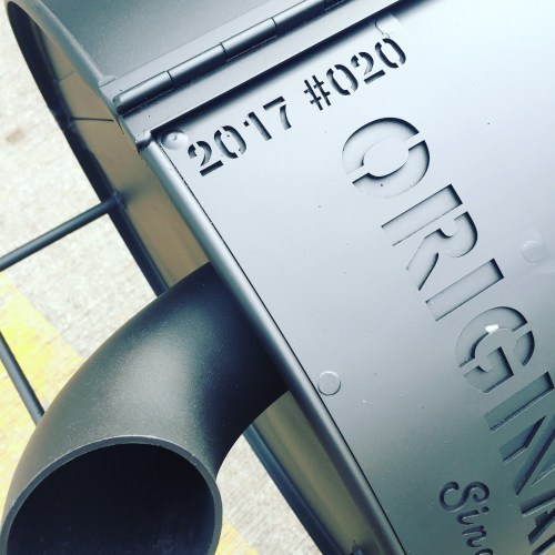 close up of an oil drum BBQ