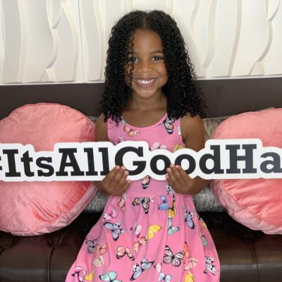 Natural Hair Love - Young girl loving her natural hair