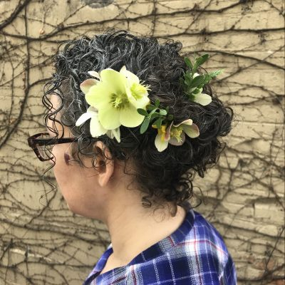 Curly hair updo picture withflowers in hair.