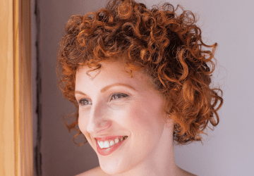 Beautiful short curly hair cut done at the Original Moxie Salon. The model has Fine Density hair and the cut was our specialty Moxie Method.
