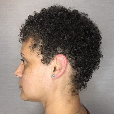 Female with tapered fade haircut.