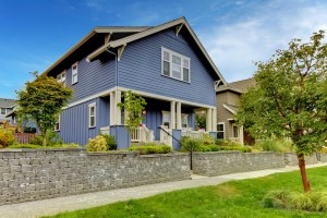 Poptop Addition with beautiful blue siding and brown exterior trim