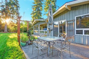 Backyard Addition to Expand Living Space with Small Paver Patio