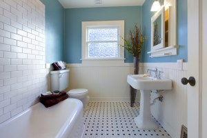 3-Piece Bath Remodel with Classic Pedestal Sink, Black and White Mosaic Tile Floor, Corner Tub with White Subway Tile, Perimeter Painted Beadboard Wainscot and Built-In Medicine Cabinet