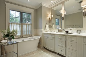 Master Bathroom Remodel with Marble Topped 2 Sink Vanity, Large Pedestal Tub and Perimeter Subway Tile