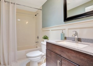 3-Piece Bath Remodel with White on White Octagon-Dot Floor Tile, Stained Alder Vanity and Painted Board and Batten Wainscot