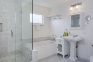 Bathroom Remodel with large Walk-In Shower, Soaking Tub, Pedestal Sink and Toilet with Carrara Marble Finishes Throughout
