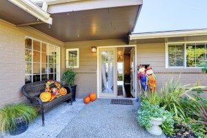 Exterior Remodel of Brown Painted Home with Covered Rear Patio and Double Doors
