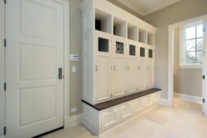 Interior Remodel with Locker Style Cubbies in Mudroom, Built-in with White Cabinetry and a Stained Wood Benchtop