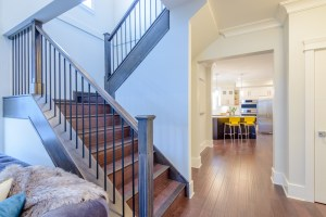 Interior Remodel with Stained Wood Stairs and Open Railing Landing in Living Room