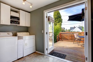 Whole House Remodel with Laundry Room and Mudroom, including White Painted Cabinets and Tile Flooring with Double Doors to the Back Deck