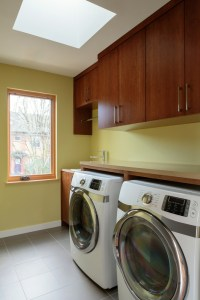 Whole House Remodel with Laundry Room, including Stained Wood Cabinets, Built-In Washer and Dryer and Tile Floor