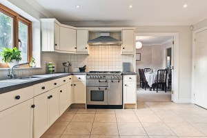 Whole House Remodel with Kitchen, including White Painted Cabinets, Dark Countertops, Full Height Tiled Backsplash, Tile Floor and Open Plan