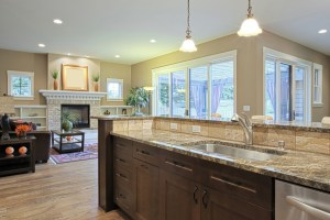 Whole House Remodel with Kitchen, including Stained Wood Cabinets, Granite Countertops and Island with Sink and Dishwasher in Open Floor Plan
