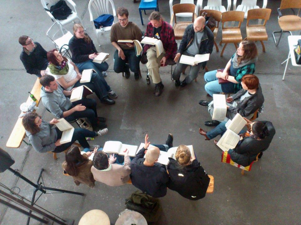 Early arrivals for the Germany Convention sing and socialize at an artist's studio on Chemnitzstraße, May 28, 2014. Photograph by Philip Jacobs.