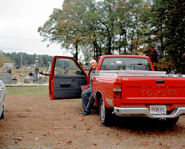 B. M. sits in his truck at Holly Springs.