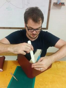 person repairing a book