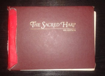 Sacred Harp with spine covered in tape