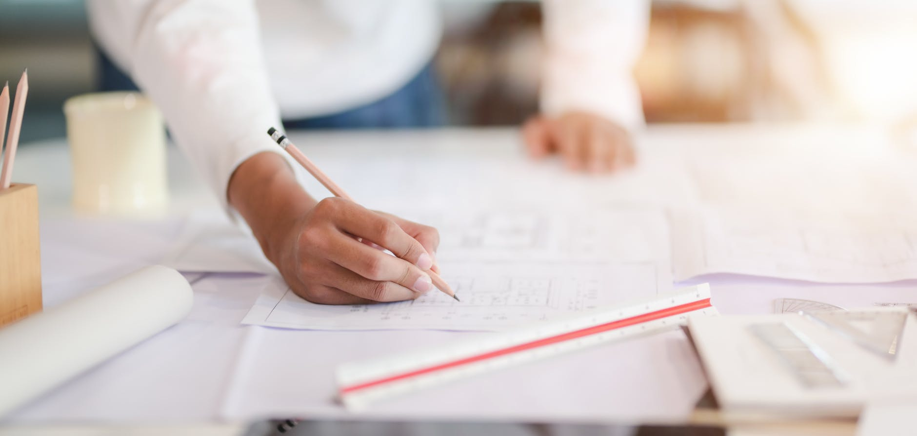 photo of person writing on paper