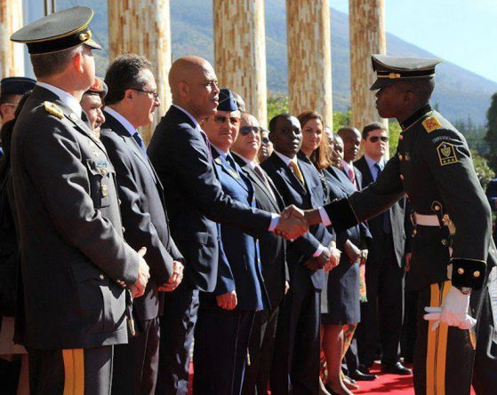 Dimitri-Herard-shaking-hands-with-Michel-Martelly-in-Quito-Ecuador-where-he-was-trained.jpg
