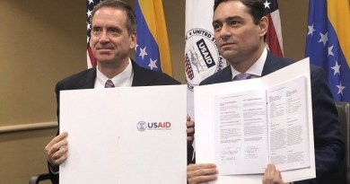 Guaido Signs USAID Agreement as Adobe Suspends Venezuela Service