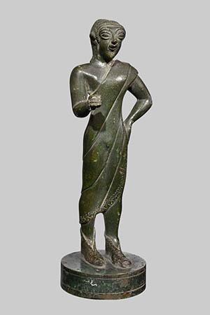 Offerente togato bronzo 600 a.C. ca. dall'isola d'Elba