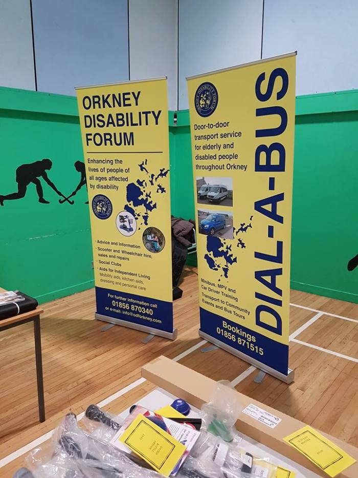 gym hall with orkney disability forum signs