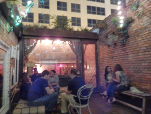 Beautiful rooftop seating at Hanson's Shoe Repair - AKA the cool speakeasy bar in Downtown Orlando