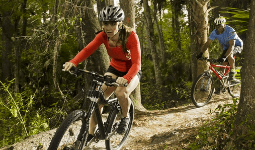 Best free & cheap things to do in Orlando: image of a couple biking on a trail in Seminole County