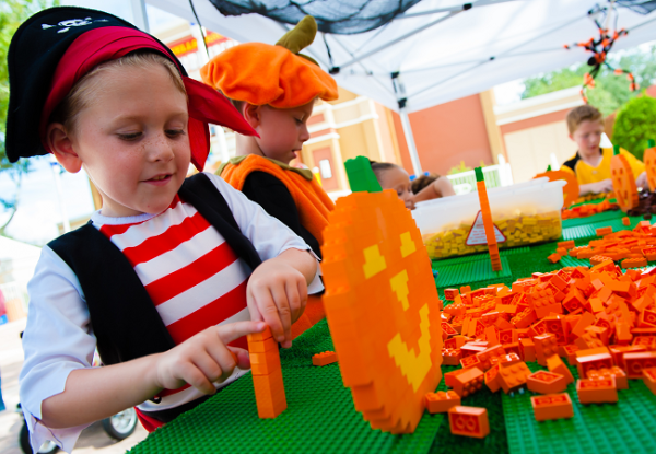 Brick or Treat at LEGOLAND: image of kid making a pumpkin out of LEGOS