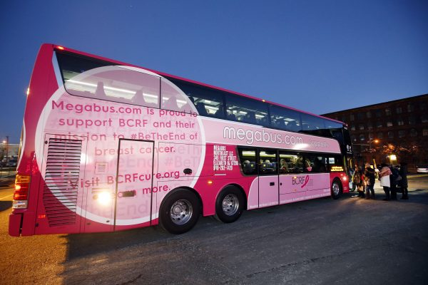 Breast cancer survivors and their families board the new Breast Cancer Research Foundation pink Megabus for its inaugural trip to New York City, Tuesday, Jan. 19, 2016 in Elizabeth, N.J. Megabus.com is donating $1 for every ticket sold today to the Breast Cancer Research Foundation. (Jason DeCrow/AP Images for Megabus.com)