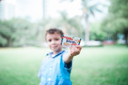 Orlando library free resources: image of a child holding his library card