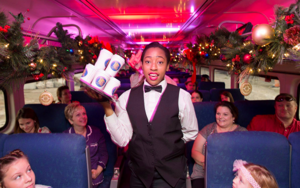 The Polar Express Train Ride Orlando: image of server with hot cocoa