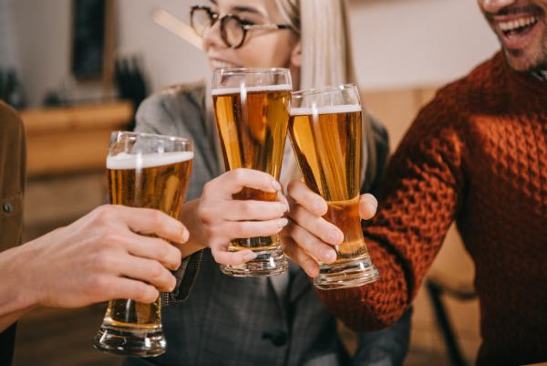 Best happy hour spots in Orlando: image of people drinking beer