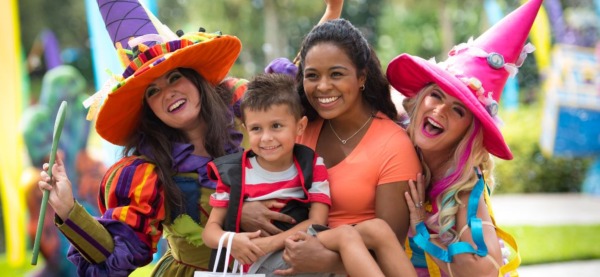 image of family smiling at SeaWorld Orlando's Halloween Spooktacular