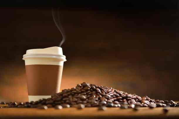 National Coffee Day deals: image of coffee beans and a to-go cup of coffee