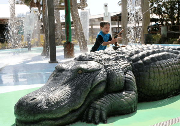 Gatorland Orlando deals: image of child playing at alligator themed splash pad at Gatorland Orlando