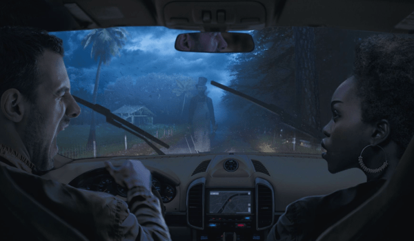 Halloween Orlando: image of couple driving down the scary attraction, The Haunted Road in Orlando