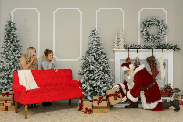 Best places to meet Santa in Orlando: image of Santa and friends at a holiday photo backdrop at Wall Crawl Orlando