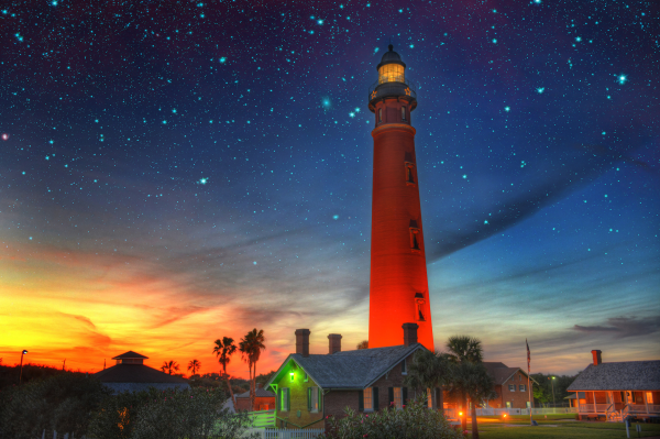Free and cheap things to do in Volusia County: image of the Ponce Inlet Lighthouse at night. The Lighthouse is a cheap thing to do in Volusia County just a short drive from Orlando, Florida