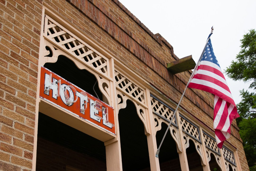 Front of hotel with flag